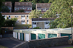 Suburban terraced housing and garages dating from 1970s, Bath, Somerset, England