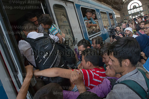Illegal migrants board a train at the main railway station Keleti in Budapest, Hungary on September 03, 2015. ATTILA VOLGYI