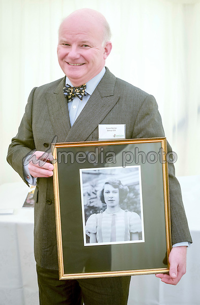 01 February 2016 - London, England - A previously unseen and deemed private photograph of Queen Elizabeth II taken by photographer Lawrence Audrain in 1939 which was  presented to Prince Charles the Prince of Wales at international development charity Send a Cow's headquarters in Newton St Loe, Bath. Send a Cow works in seven countries in Africa, providing some of the continent's poorest people with training, tools, seeds and livestock to help lift themselves out of poverty. Photo Credit: Alpha Press/AdMedia