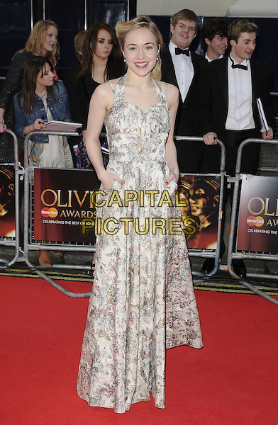 SARAH GOLDBERG.The 35th Laurence Olivier Awards,.Theatre Royal, Drury Lane, London.England, UK..March 13th 2011.full length print dress white black halterneck maxi hands in pockets .CAP/CAN.©Can Nguyen/Capital Pictures.