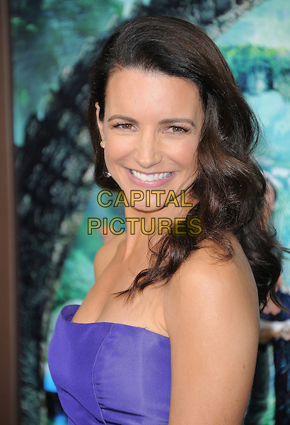 "Kristin Davis.The L.A. Premiere of ""Journey 2: The Mysterious Island"" held at The Grauman's Chinese Theatre in Hollywood, California, USA..February 2nd, 2012.headshot portrait purple strapless side smiling .CAP/RKE/DVS.©DVS/RockinExposures/Capital Pictures."