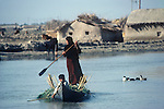 Marsh Arabs. Southern Iraq. Circa 1985. Children and mother in boats. Haur al Mamar or Haur al-Hamar marsh collectively known now as Hammar marshes Irag 1984