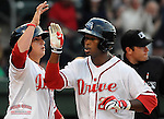 Left fielder Brandon Jacobs (24) of the Greenville Drive, Class A affiliate of the Boston Red Sox, is congratulated by Christian Vazquez (15) after hitting a home run in a game against the Augusta GreenJackets on Opening Day, April 7, 2011, at Fluor Field at the West End in Greenville, S.C.