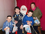 Evan, Sean and Oran Murray and Draoi Kennedy pictured with Santa when he paid a visit to Slane. Photo:Colin Bell/pressphotos.ie