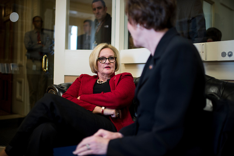 UNITED STATES - OCTOBER 30: Sen. Claire McCaskill, D-Mo., left, and Sen. Susan Collins, R-Maine, talk in the Senate Radio/TV Gallery office before their news conference announcing bipartisan legislation that would strengthen security clearance background checks on Wednesday, Oct. 30. 2013. (Photo By Bill Clark/CQ Roll Call)