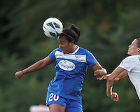 Boston Breakers substitute midfielder Mariah Noguiera (20) heads the ball.  In a National Women's Soccer League (NWSL) match, Boston Breakers (blue) tied Western New York Flash (white), 2-2, at Dilboy Stadium on August 3, 2013.