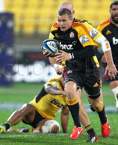17.03.2013 Wellington, New Zealand. Chiefs' Robbie Robinson on the attack during the 2013 Super Rugby season - Hurricanes v Chiefs, Westpac Stadium...