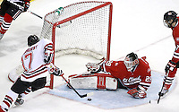 Terry Broadhurst tries to stuff the puck past St. Cloud State goalie Ryan Faragher during the final seconds of the second period. Nebraska-Omaha defeated St. Cloud State 4-3 Saturday night at CenturyLink Center in Omaha. (Photo by Michelle Bishop) .