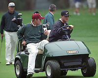 Golfer Casey Martin driving golf cart with caddy .<br />