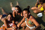 "Bathers enjoy the artificial pool of Piscinão de Ramos, or ""big pool of Ramos"", in the north zone of Rio de Janeiro, Brazil, on Saturday, November 1, 2014. Thousands of people who live in the surrounding favelas go every summer. The pool, which opened in December 2001, holds 30 million liters of water."