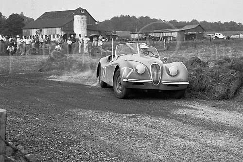 Jaguar XK 120 oversteers into hay bales during race at Callicoon, NY, 1953. Driver is John L. Stanwycks Jr. of Uniondale, NY (according to event program)