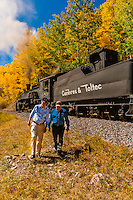 Governor John Hickenlooper of Colorado walking with C&TSRR Railroad Superintendent Marvin Casias, who has been with the C&TSRR since the day it started in 1970. On a visit to the the Cumbres & Toltec Scenic Railroad, from Antonito to Osier, Colorado during peak autumn color. The Cumbres & Toltec Scenic Railroad has been jointly owned by the States of Colorado and New Mexico since 1970 when it was purchased from the Denver and Rio Grande Western Railway, which was going to scrap the line. The train makes a 64 mile run between Antonito, Colorado and Chama, New Mexico. The railroad is the highest and longest narrow gauge steam railroad in the United States with a track length of 64 miles. The train traverses the border between Colorado and New Mexico, crossing back and forth between the two states 11 times. The narrow gauge track is 3 feet wide. It runs over 10,015 ft (3,053 m) Cumbres Pass.