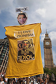 "London, UK. 26 July 2014. A T-shirt with a Barack Obama mask and the slogan ""I love Zionism"". Protesters gather in Parliament Square and Whitehall after a march from the Israeli Embassy in Kensington to call for an end to the Israeli military action against the Palestinians in the Gaza Strip at a political rallye."