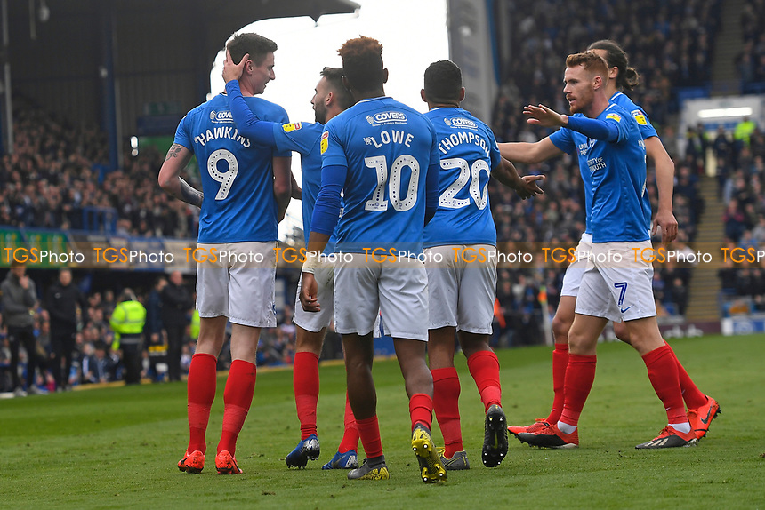 `p9` left is mobbed after scoring the first goal during Portsmouth vs Rochdale, Sky Bet EFL League 1 Football at Fratton Park on 13th April 2019