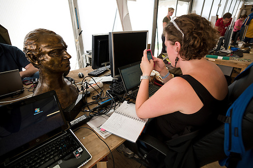 Busy working, a sculpture of the King of Sweden is on the desk.