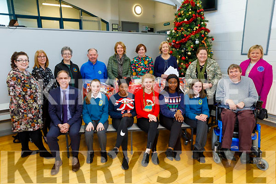 The staff and students present cheques to Recovery Haven, Kerry Cancer Support, Adapt, Tralee Soup Kitchen, Irish Wheelchair Assoc and the Kerry Adolescence Counselling Service at the school on Tuesday.  <br /> Seated l to r: Pat Fleming (Deputy Principal), Kate Sweeney, Oriste Jolomi, Ellie Stack, Debbie Obilma, Rachel Prenderville and Terry O'Brien (IWA).<br /> Back l to r: Cora McElligott (Teacher), Colette Price (Tralee Soup Kitchen), Breda Dyland, Joe Hennebry, Mary Barron, Ann Marie Prendeville, Nora Quane (Deputy Principal), Catherine Casey (Adapt Kerry) and Caroline Flahive (KACS).