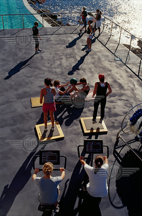 People train at the Icebergs Club gym and swimming pool on Bondi Beach in Sydney.