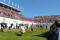 The 2017 FedEx Champion Justin Thomas (USA) makes his way to the first tee to the roar of the crowd during round 4 Singles of the 2017 President's Cup, Liberty National Golf Club, Jersey City, New Jersey, USA. 10/1/2017. <br /> Picture: Golffile | Ken Murray<br /> <br /> All photo usage must carry mandatory copyright credit (&copy; Golffile | Ken Murray)