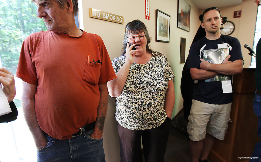 Joann Rackliff, center, of Manchester, N.H., calls her son to tell him he won, during the New Hampshire moose lottery drawing at the Department of Fish and Game in Concord, N.H., Friday, June 15, 2012 . (Cheryl Senter for the New York Times)