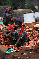 A female worker works at constructino site in Madras, India.