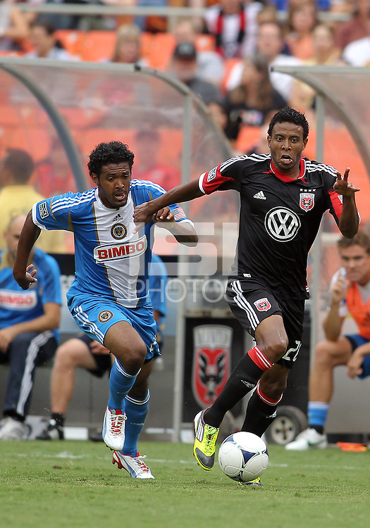 WASHINGTON, D.C. - AUGUST 19, 2012:  Lionard Pajoy (26) of DC United moves the ball away from Sheanon Williams (25) of the Philadelphia Union during an MLS match at RFK Stadium, in Washington DC, on August 19. The game ended in a 1-1 tie.