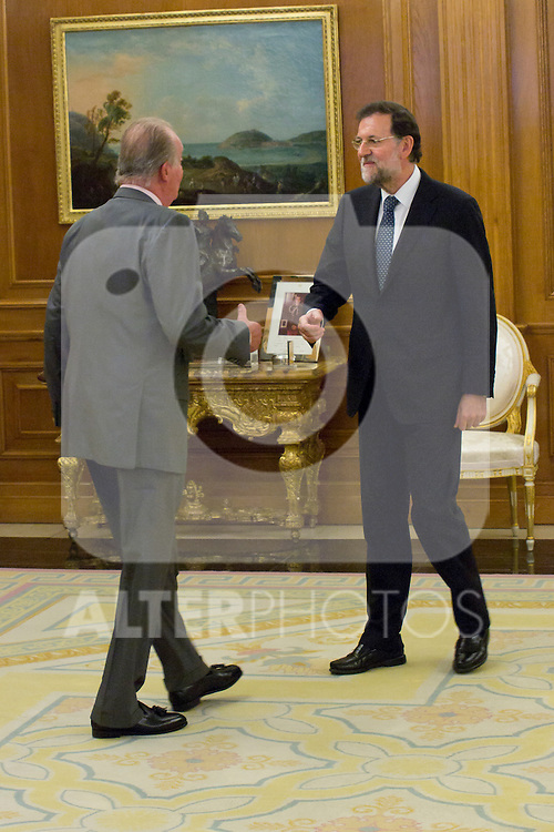 22.08.2012. King Juan Carlos of Spain receives the President of the Government of Spain Mariano Rajoy Brey in the Zarzuela Palace in Madrid. In the image (L-R) King Juan Carlos and Mariano Rajoy Brey (Alterphotos/Marta Gonzalez)