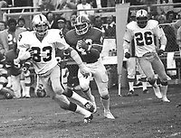 Oakland Raider linebacker Ted Hendricks runs with interception against the Denver Broncos..(1975 photo/Ron Riesterer)
