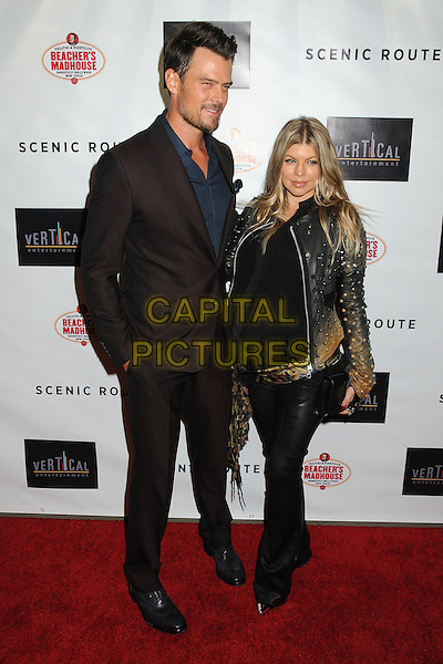 Josh Duhamel, Stacy Duhamel (nee Ferguson) aka Fergie<br /> &quot;Scenic Route&quot; Los Angeles Premiere held at the TCL Chinese 6 Theatre, Hollywood, California, USA.<br /> August 20th, 2013<br /> full length brown suit blue shirt stubble facial hair jacket black leather trousers brown belt pregnant married husband wife <br /> CAP/ADM/BP<br /> &copy;Byron Purvis/AdMedia/Capital Pictures