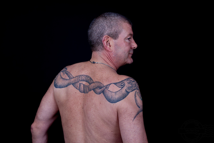 Danish man with at viking style double headed dragon tattooed across his shoulders. The dragon is tattooed by Erik Reime from Kunsten på Kroppen.