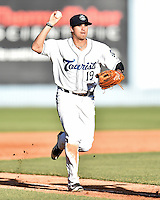 Asheville Tourists third baseman Josh Fuentes (19) pursues the runner during game one of a double header against the Kannapolis Intimidators at McCormick Field on May 21, 2016 in Asheville, North Carolina. The Tourists defeated the Intimidators in game one 3-2. (Tony Farlow/Four Seam Images)