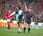 Neil Ruddock of Liverpool receives a yellow card  from referee Paul Danson - Premier League - Nottingham Forest v Liverpool - City Ground - Nottingham - England - 23rd March 1996 - Picture Simon Bellis/Sportimage