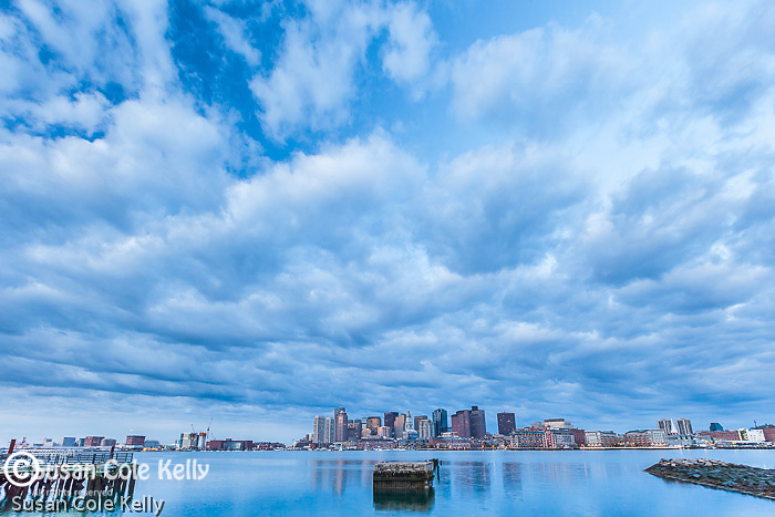 A dramatic, cloudy sunrise over Boston Harbor, Boston, Massachusetts, USA