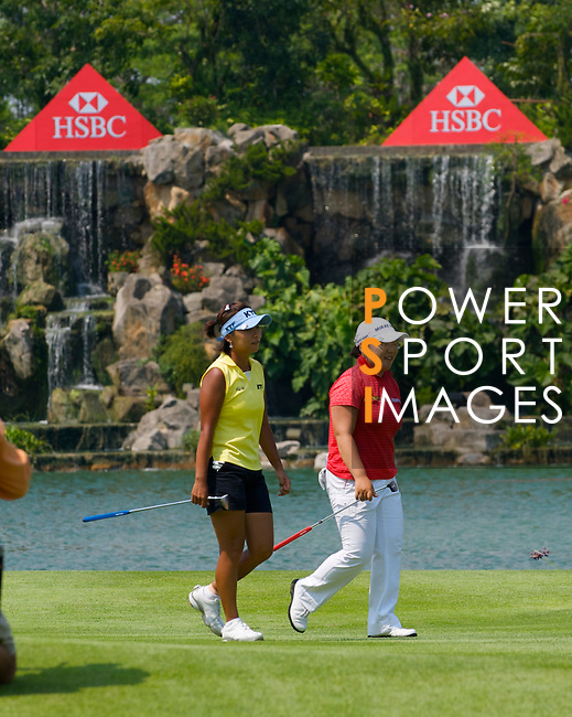 SINGAPORE - MARCH 08:  Jiyai Shin of South Korea and compatriot Mi Hyun Kin walk on the par four 18th hole during the final round of HSBC Women's Champions at the Tanah Merah Country Club on March 8, 2009 in Singapore.  Photo by Victor Fraile / The Power of Sport Images