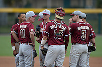 Florida State Seminoles head coach Mike Martin (11) talks with pitcher pitcher Billy Strode (5), catcher Danny De La Calle (13) and first baseman John Nogowski (3) during a game against the South Florida Bulls on March 5, 2014 at Red McEwen Field in Tampa, Florida.  Florida State defeated South Florida 4-1.  (Mike Janes/Four Seam Images)