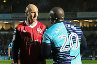 Kevin Ellison of Morecambe and Adebayo Akinfenwa of Wycombe Wanderers during the Sky Bet League 2 match between Wycombe Wanderers and Morecambe at Adams Park, High Wycombe, England on 12 November 2016. Photo by David Horn.
