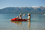 Family playing in the water at Lake Tahoe at Sand Harbor.