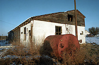 Self portrait with one of the old, dilapadated buildings on my dad's farm in Parma, Idaho in 1994.