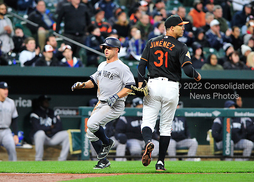New York Yankees left fielder Brett Gardner (11) runs past Baltimore Orioles starting pitcher Ubaldo Jimenez (31) to score the first run of the game in the first inning at Oriole Park at Camden Yards in Baltimore, MD on Friday, April 7, 2017.<br /> Credit: Ron Sachs / CNP<br /> (RESTRICTION: NO New York or New Jersey Newspapers or newspapers within a 75 mile radius of New York City)