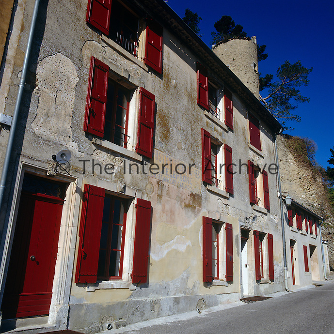 This traditional Menerbes townhouse with its bright red shutters and front door belies its contemporary interior