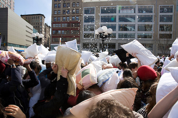 "People celebrate International Pillow Fight Day in New York's Union Square.  The pillow fight is a fun, free event that is part of the urban playground movement, an effort to get people outside their homes and celebrate public spaces as ""urban living rooms."""