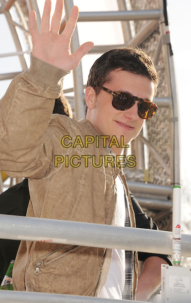 Josh Hutcherson.arriving at the 2012 Nickelodeon Kids' Choice Awards at Galen Center in Los Angeles, California, USA..March 31st, 2012.half length white top brown jacket hand palm waving side sunglasses shades .CAP/ROT/TM.©Tony Michaels/Roth Stock/Capital Pictures
