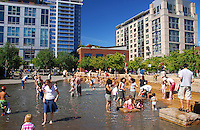 Families gather at Jamison Square Fountain located in the Pearl District of NW Portland