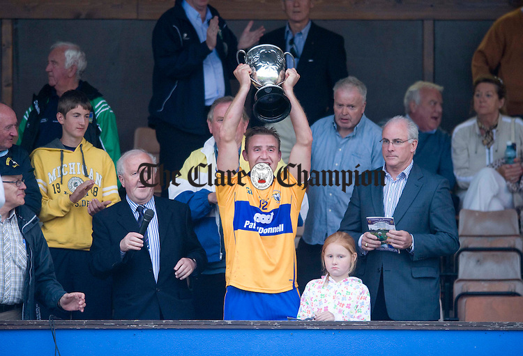 Tony Carmody holds aloft the trophy following victory over Limerick in the Intermediate  Munster hurling final at Cusack Park. Photograph by Declan Monaghan