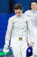 27 FEB 2011 - LONDON, GBR - Italian Irene Vecchi walks dejectedly from the piste at the end of the bronze medal match at fencing's  England Cup team sabre tournament after her opponent, Bogna Jozwiak, had taken the winning point to give Poland a 45-44 victory .(PHOTO (C) NIGEL FARROW)