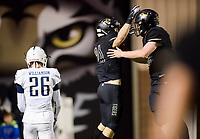 NWA Democrat-Gazette/CHARLIE KAIJO Bentonville High School Harrison Campbell (21) reacts after a score during a football game, Friday, November 2, 2018 at Bentonville High School in Bentonville.