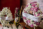 19 October 2013, Pakse, Laos:  Wreaths of flowers for the missing passengers at the Chinese temple being used as a makeshift morgue in downtown Pakse, Laos following a crash of a Lao Airlines plane into the Sedon river. The aircraft crashed into the Mekong River tributary on approach to Pakse airport from Vientiane in severe weather killing all 44 passengers and 5 crew on board. Only the youngest of the family , Manfred has been recovered and identified. Rescue workers are still dragging the fast flowing river for further remains and the main body of the plane.  Picture by Graham Crouch