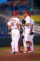 Springfield Cardinals starting pitcher Daniel Poncedeleon (23) and catcher Carson Kelly (5) talk with pitching coach Jason Simontacchi (46) as second baseman Bruce Caldwell (8) listens in during a game against the Northwest Arkansas Naturals on April 26, 2016 at Hammons Field in Springfield, Missouri.  Northwest Arkansas defeated Springfield 5-2.  (Mike Janes/Four Seam Images)