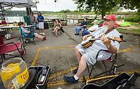 NWA Democrat-Gazette/BEN GOFF @NWABENGOFF<br /> Gary Shipley of Springdale plays his banjo Saturday, Aug. 10, 2019, during the Heroes on the Water event at Lake Fayetteville.
