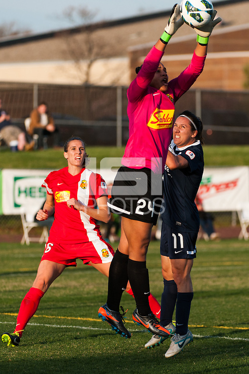 Western New York Flash goalkeeper Adrianna Franch (24) grabs a ball intended for Sky Blue FC forward Lisa De Vanna (11). Sky Blue FC defeated the Western New York Flash 1-0 during a National Women's Soccer League (NWSL) match at Yurcak Field in Piscataway, NJ, on April 14, 2013.