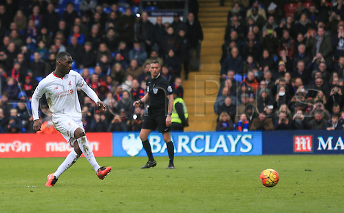 06.03.2016. Selhurst Park, London, England. Barclays Premier League. Crystal Palace versus Liverpool. Christian Benteke of Liverpool scores from the penalty spot in the last minute to win the game.